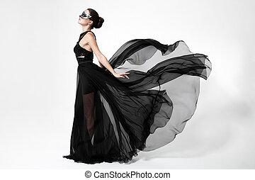 mode, vrouw, in, het wapperen, black , dress., witte , achtergrond.