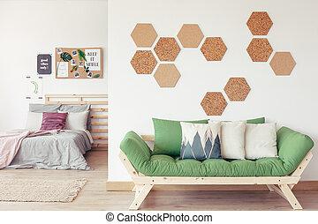 modelé, sofa, oreiller vert