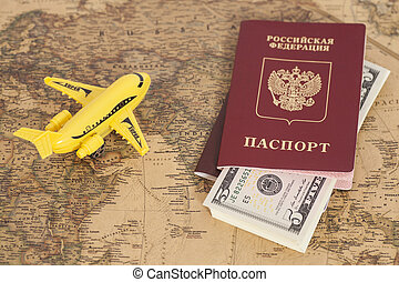 Model aircraft with Russian International passports and dollars on the world map