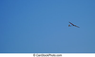 Model airplane flying in blue sky