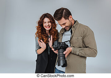 model and photographer with photo camera
