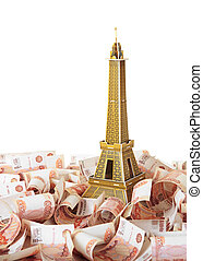Model Eiffel Tower in the background of Russian banknotes