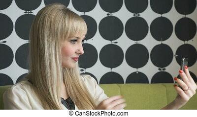 Model girl making selfie photo on smartphone