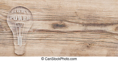 model glass bulb lamp on wooden background