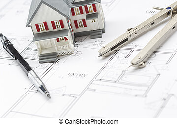 Model Home, Pencil and Compass Resting On House Plans
