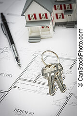 Model Home, Pencil and Keys Resting On House Plans