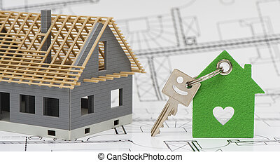 model home standing on construction plan and house key
