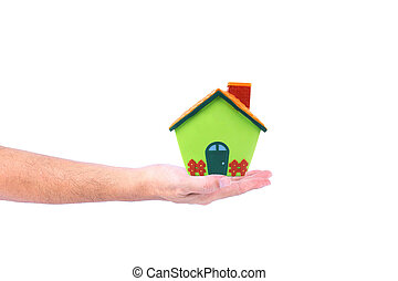 Model house in man hand isolated on a white background