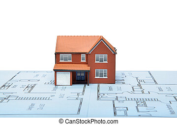 A model house on blueprints with white background