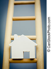 Model House On Rung Of Wooden Property Ladder