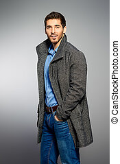 model in a coat - Handsome man wearing jeans clothes and a...
