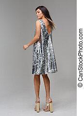 Model in a grey dress