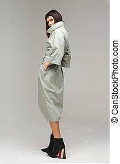 Model in a white cloak