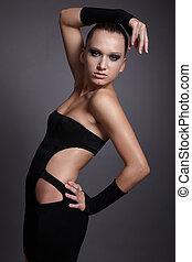 model in black dress - portrait of beautiful dark haired...