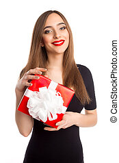 Model in black dress with present box
