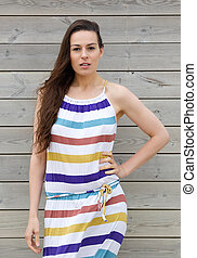 Model in colorful striped summer dress