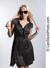 Model in dress wearing sunglasses