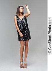model in dress with rhinestones dance