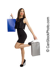Model in dress with shopping bags