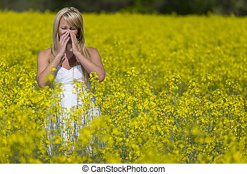 A blonde model in a field of flowers with allergies