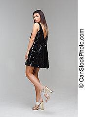 Model in short black dress