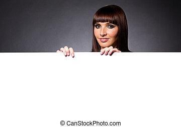 Model in Studio Behind Large Blank Sign