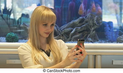 Model making selfie photo using smartphone