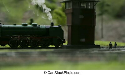 Model of a steam locomotive with smoke