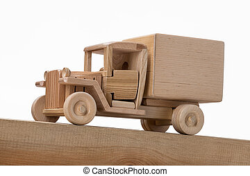 Model of a wooden old truck on an inclined wooden surface.