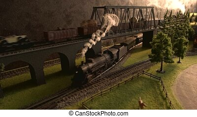 Model of freight steam train crossing the bridge.
