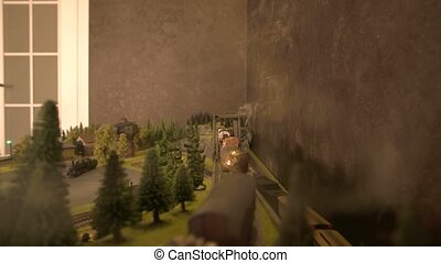 Model of freight train moving on railroad.