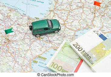 model of green car and notes on Europe map
