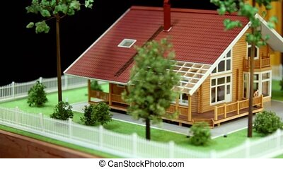 Model of house and adjacent area with plants