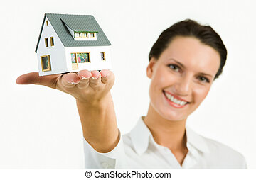 Model of house - Image of young beautiful woman presenting...