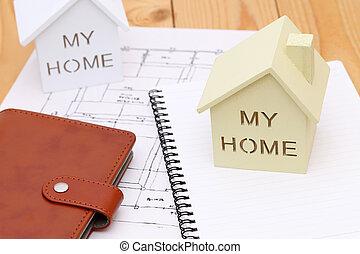 Model of house on blueprints - Wooden model of house on...