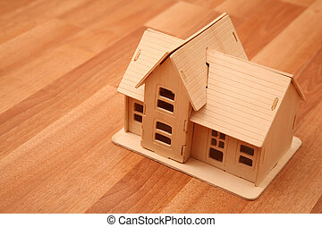 model of house on the wooden foor