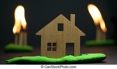 Model of house surrounded by flame. Wildfire and house...