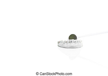 Model of plaster teeth with dental tools isolated in with background.