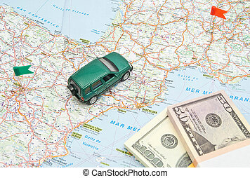 model of the green car and money on map