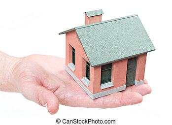 Model of the small house in human hands.
