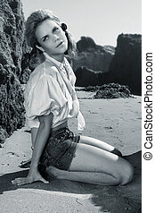 Model on rocky beach