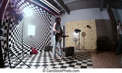 Model participates in photosession with guitar, time lapse