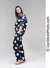 Model posing in a polka dot costume pajamas