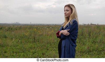 model posing in the field