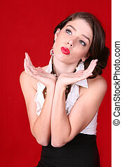 Model Posing With Her Hands on Red Background