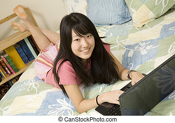 Model Release 363 Asian American teen working on laptop computer