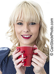 Model Released. Attractive Young Woman Drinking a Cup of...