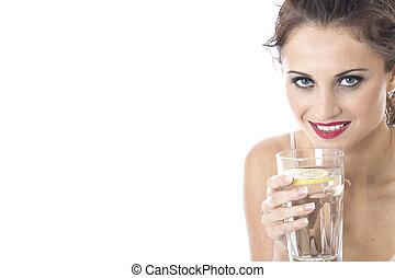 Model Released. Attractive Young Woman Drinking a Glass of Water