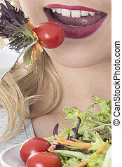 Model Released. Attractive Young Woman Eating Salad