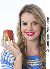 Model Released. Attractive Young Woman Holding an Apple